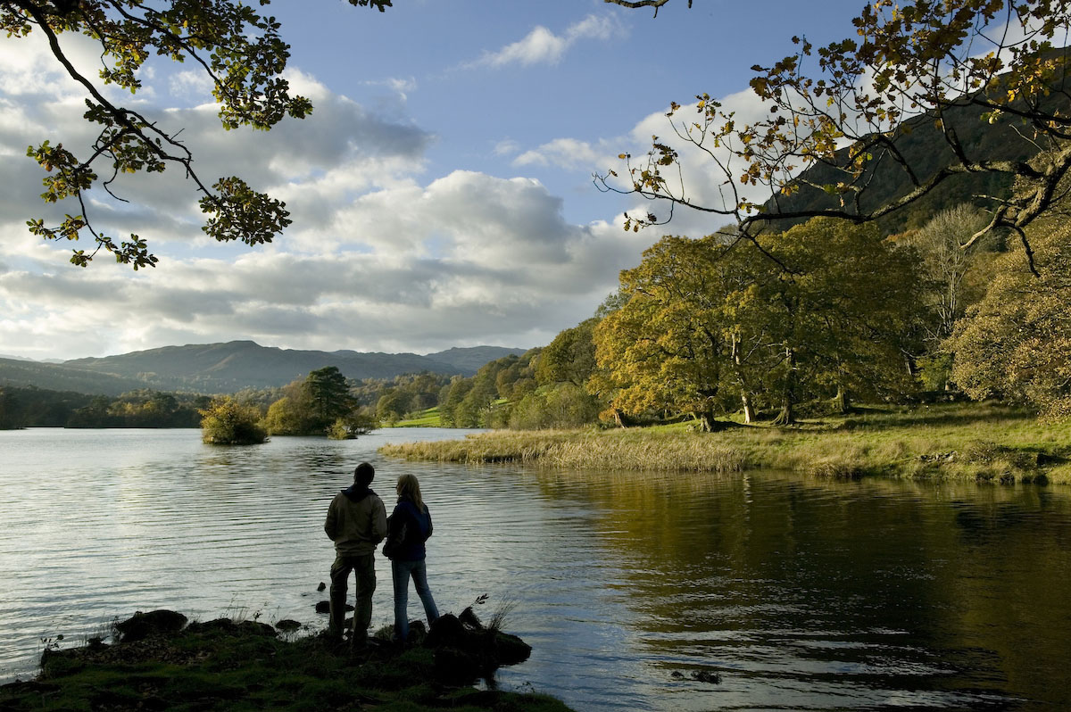 Couple in shaddow on the shore of Rydal Water.